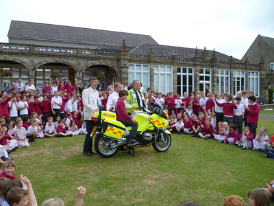 The new bike is surrounded by pupils from All Hallows School.