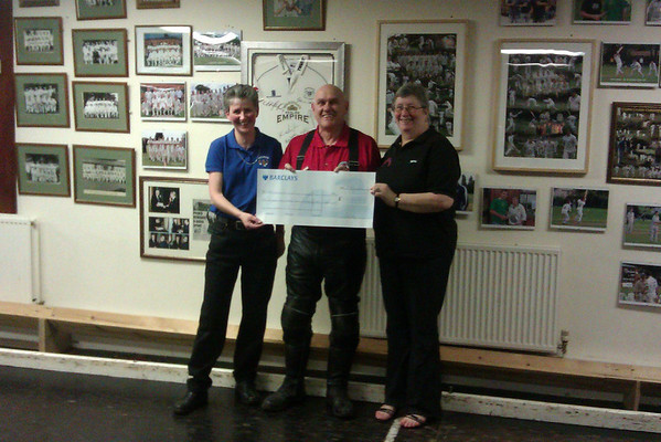 Richard receiving a cheque